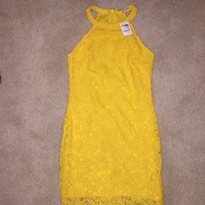 Yellow fancy dress with tags